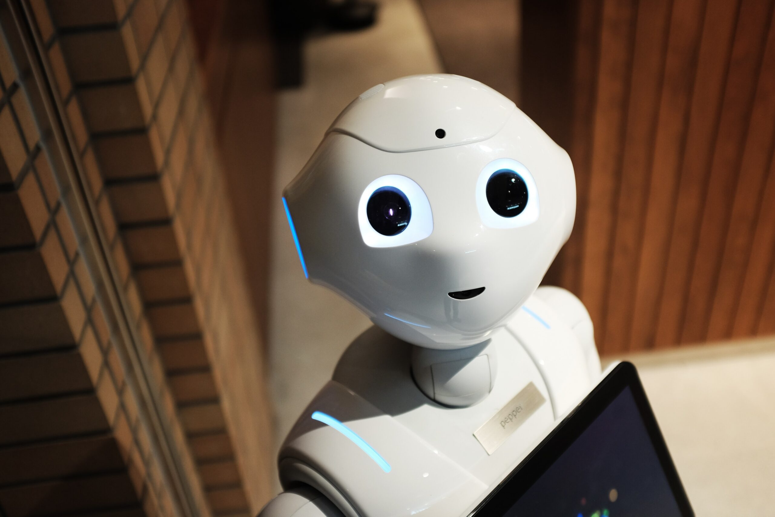 picture of a robot representing automation not replacing humans